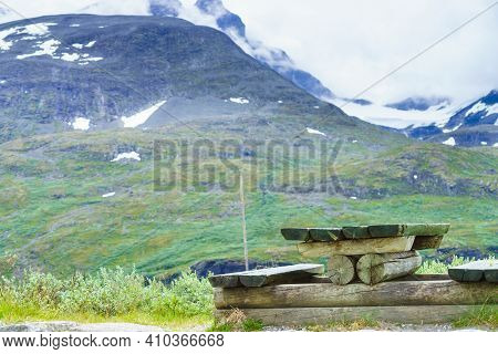 Picnic Site Wooden Table And Benches Witn View At Norwegian Snowy Mountains, Scandinavia Europe.