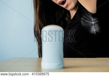Girl Surprising By Deodorant Stains On Black Clothes