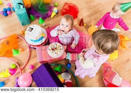 Birthday party in kindergarten with cake and presents