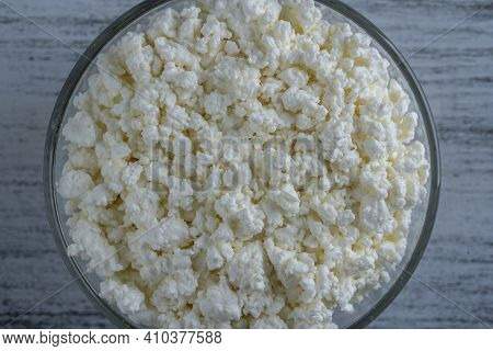 Cottage Cheese In Glass Bowl Of Background, Top View. White Grainy Texture Of Dairy Product, Cottage