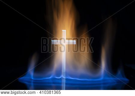 Cross Or Crucifix Surrounded By Burning Fire Flames. Religious Theme.