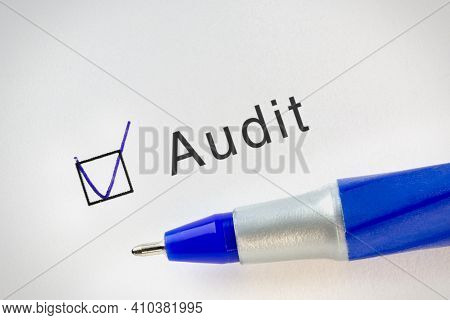 Audit Accounting And Financial Concept Text On Test Paper With Check Mark In Form Box. Business Term