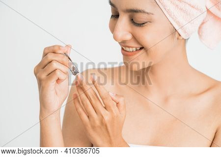 Woman Doing Manicure With Cutting Her Fingernail Over White Background Healthy Care Concept.