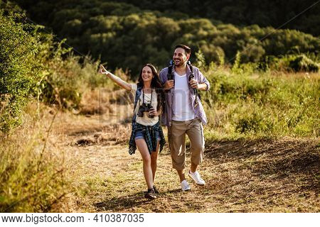 Happy Couple Is On Vacation And Hiking In Forest.