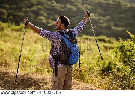 Adult Man Is Excited While Hiking In Mountain.