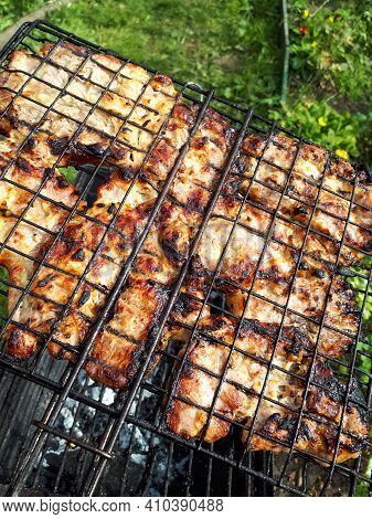 Grilling Chicken Meat On The Barbecue Charcoal Grill In The Garden
