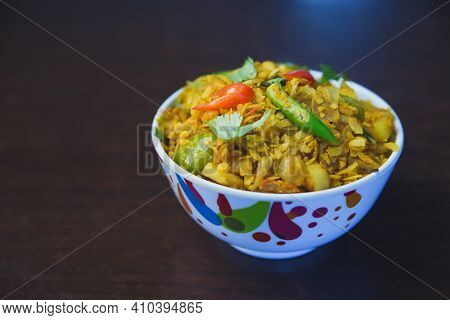 Fried Beaten Rice With Potato,onion,capsicum And Green Chillies In Indian Nepali Style Served In A B