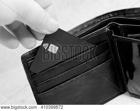 Brown Wallet With Credit Card So Close