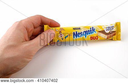Lviv, Ukraine - February 24, 2021: Nesquik Chocolate Bar In Hand