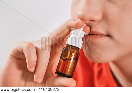 Blond Boy Drips Nose Drops From Runny Nose. Treatment Of Colds And Allergic Rhinitis. Selective Focu