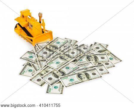 Toy bulldozer and money isolated on white background