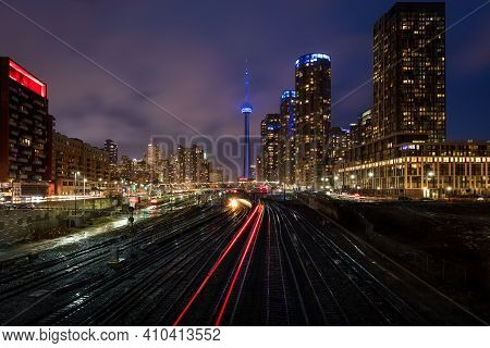 Toronto, Ontario, Canada - March 29 2018: Train Tracks In Downtown Toronto With The Cn Tower Behind