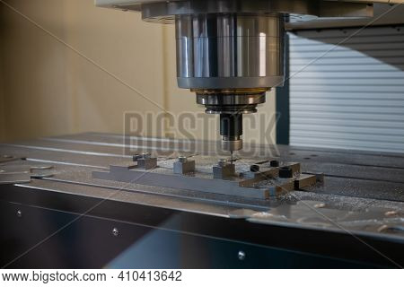 Automated Cnc Turning Milling Machine Cutting Metal Workpiece At Factory, Exhibition, Plant. Metalwo