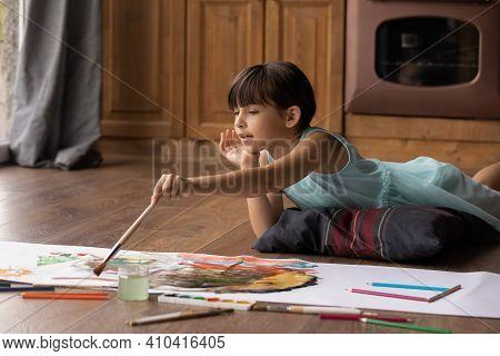 Small Latino Girl Child Drawing At Home