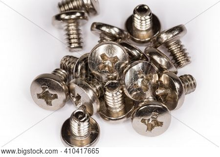 Machine Screws With Cross Recessed Pan Head And White Anti Corrosion Coating On A White Surface, Clo
