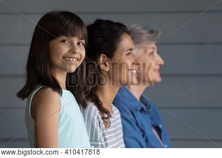 Smiling Little Latino Girl Pose With Mother And Grandmother