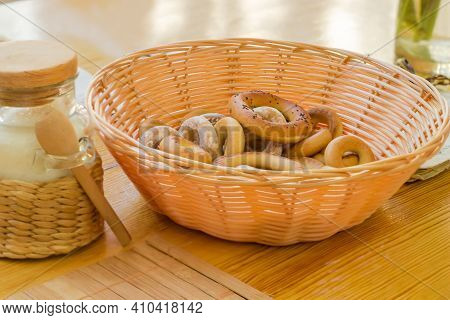 Small Crunchy Ring Shaped Cookies, So Called Sushki In Wooden Basket On A Table, Close-up In Selecti
