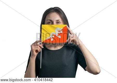 Happy Young White Woman Holding Flag Butane Flag And Covers Her Face With It Isolated On A White Bac