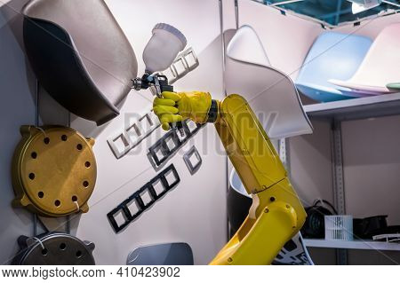Automatic Yellow Spray Painting Robotic Arm Manipulator Demonstrates Functionality At Smart Robot Te