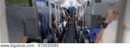 In Cabin Of The Plane Are Passengers Preparing For Flight. Travel And Travel By Air Transport Concep
