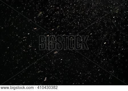 Snow Against A Black Sky. Snow On A Black Background. Snow Background.