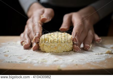 Women's Hands Form, Sculpt Cottage Cheese Pancakes On A Wooden Plank Close-up