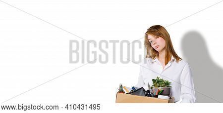 Banner, Long Format. Sad Blonde With All Her Belongings From A Working Office Place. Built On The Lo