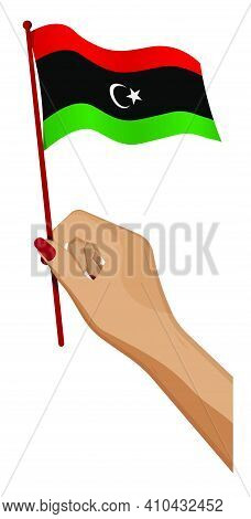 Female Hand Gently Holds Small Libya Flag. Holiday Design Element. Cartoon Vector On White Backgroun