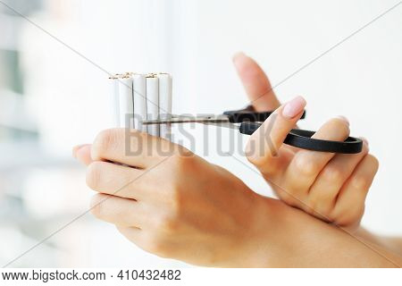Stop Smoking, Woman Cuts A Cigarette With Scissors