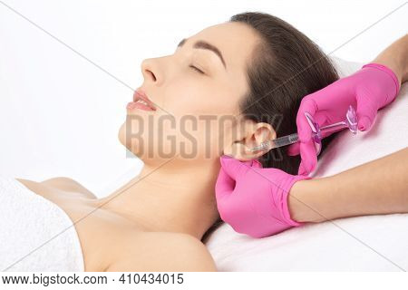 The Doctor Cosmetologist Makes The Injections Procedure For Smoothing Wrinkles And Against Flabbines