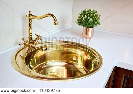 Kitchen Luxurious Interior With Golden Brass Sink And Faucet Double Tap Mixer In Contemporary Modern