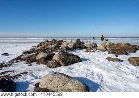 February 14, 2021 - Lomma, Sweden: Ice Covering An Ocean Bay. People Enjoy The Sunday Outing By Walk
