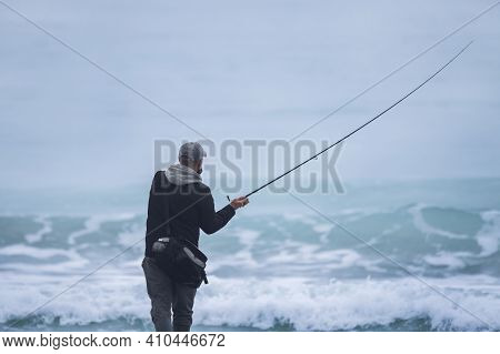 Back Shot Of An Angler About To Cast The Line