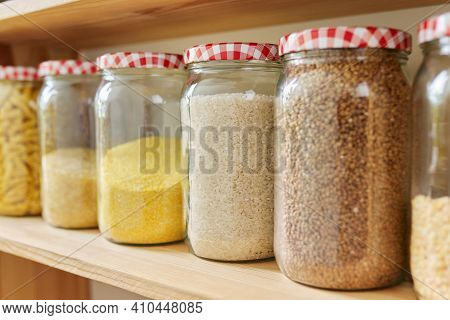 Kitchen Pantry, Wooden Shelves With Jars And Containers With Food, Food Storage. Jars Of Cereals, Bu