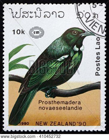Laos - Circa 1990: A Stamp Printed In Laos Shows Tui, Prosthemadera Novaeseelandie, Is An Endemic Pa