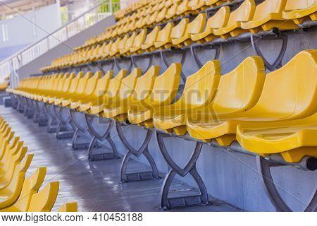 Row Of Yellow Stadium Seats In Thailand