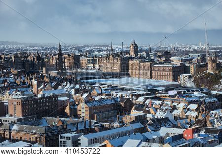 Top View Of The Winter City Of Edinburgh Covered Snow. City Attractions. Scotland, United Kingdom