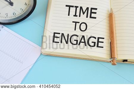 Time To Engage Text Written In Notebook. Lightblue Background. Business Concept For Engagement Invol