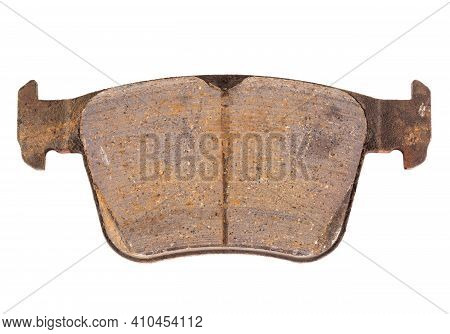 Old Worn Out And Worn Out Brake Pad On A White Background, Close-up, Isolate. Concept Of Performance