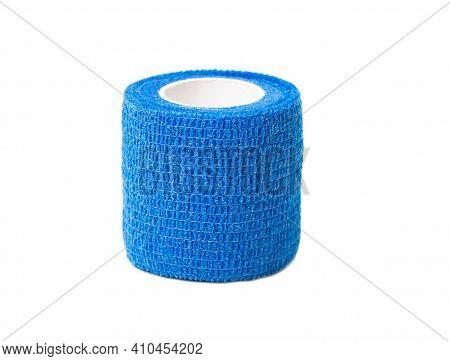 Blue Elastic Bandage On White Background, Isolate, Close-up. Bandage For Fixing Joints And Dislocati