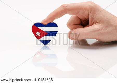 Cuba Flag. Love And Respect Cuba. A Man's Hand Holds A Heart In The Shape Of The Cuba Flag On A Whit