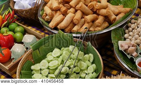 Bowls With Traditional Asian Dishes For Sale. Bowls With Fresh Vegetables And Fried Spring Rolls Pla
