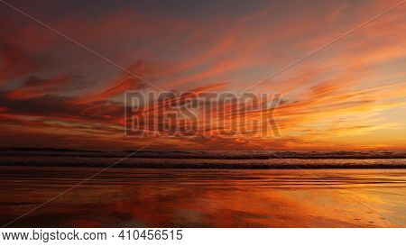 California Summertime Beach Aesthetic, Golden Sunset. Vivid Dramatic Clouds Over Pacific Ocean Waves