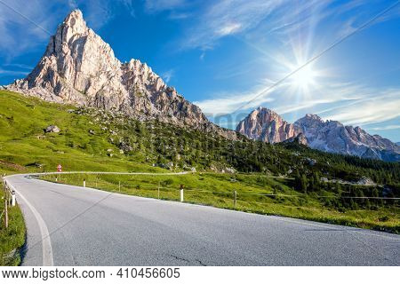 Alpine road in mounts. Road to the hight mountains. Panoramic Landscape of Alpen road, Dolomites, Italy