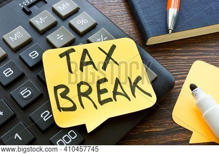 Tax Break Memo On The Calculator And Pen.