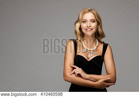 Mirthful Lady In The Evening Outlook Posing And Smiling