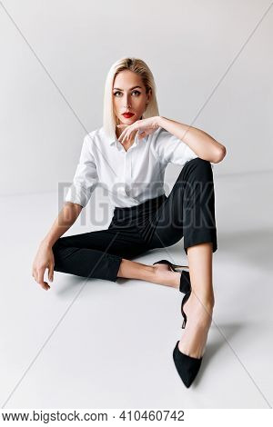 Portrait Of Daring Trendy Woman Posing On White Studio Background. Gorgeous Stylish Blonde Female We