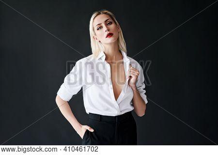 Fashion Portrait Of Sexy Trendy Woman Posing On Black Studio Background. Gorgeous Stylish Blonde Fem