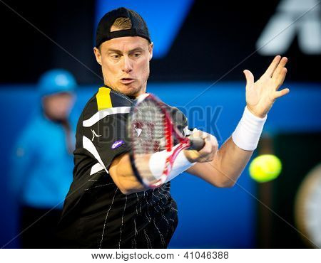 MELBOURNE - JANUARY 14: Lleyton Hewitt of Australia in his first round loss to Janko Tipsarevic of Serbia at the 2013 Australian Open on January 14, 2013 in Melbourne, Australia.