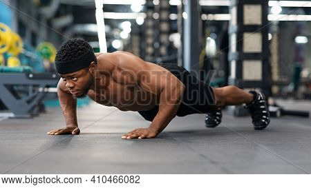 Push-ups, Press-ups Workout. Muscular African American Shirtless Guy Sportsman Building Up Muscles,